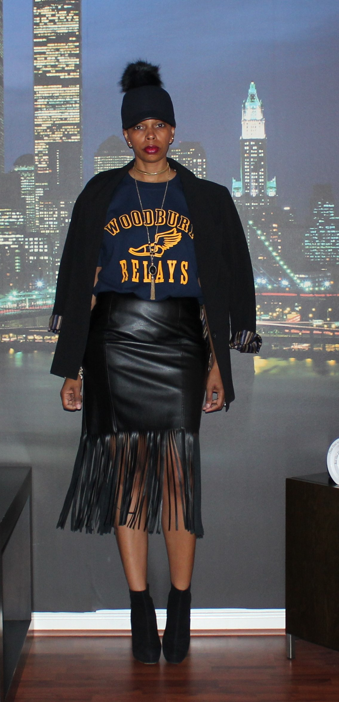 I decided to style this faux leather fringe skirt with a casual t-shirt and  a baseball cap. The fur puff ball detail ... 5474cc936c56